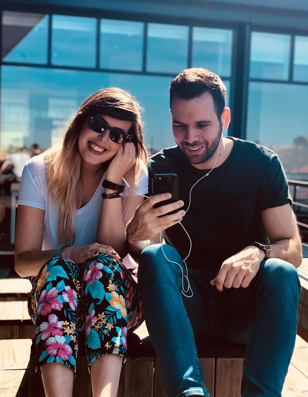 man and woman listen on headphones