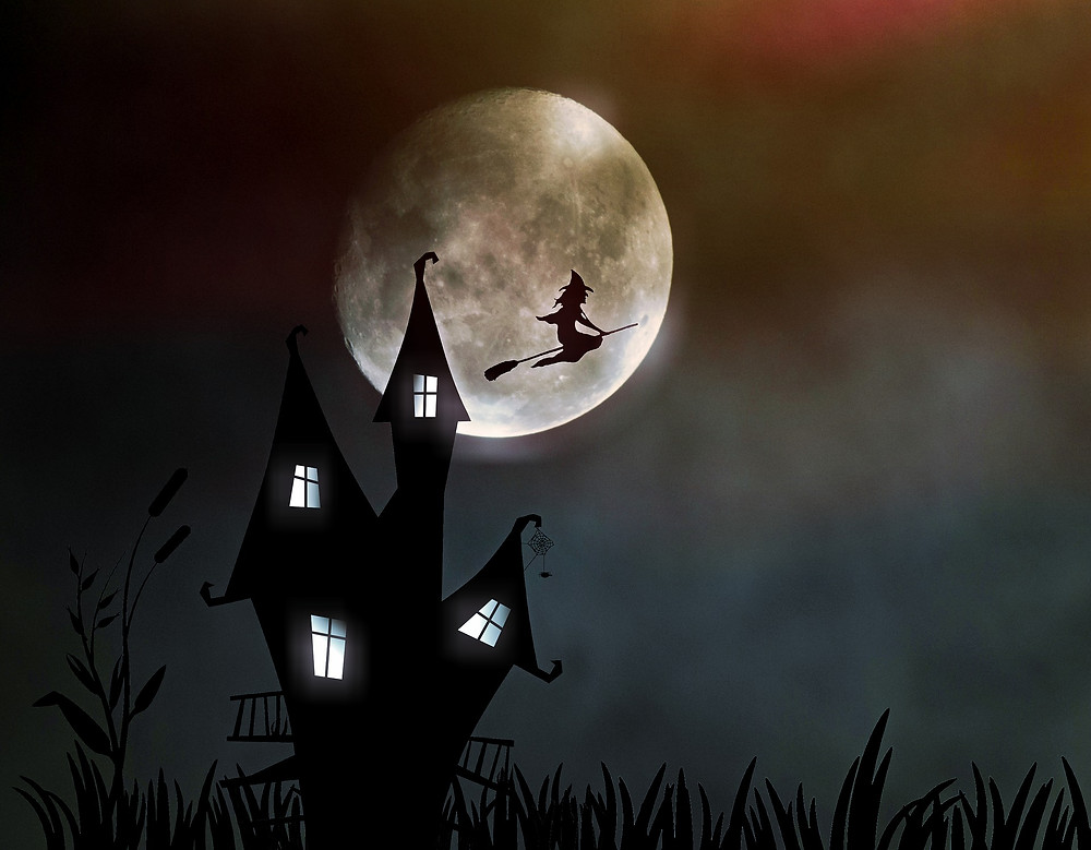 witch flies in front of a full moon