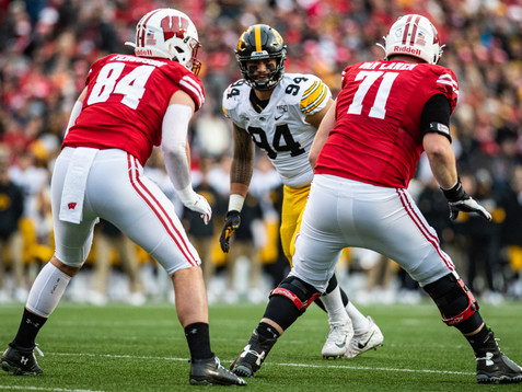 Iowa defensive end AJ Epenesa lines up before a play during a football game between Iowa and Wisconsin at Camp Randall Stadium in Madison on Saturday, November 9, 2019. The Badgers defeated the Hawkeyes, 24-22.