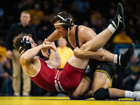 Iowa's 174-pound Michael Kemerer wrestles Wisconsin's Jared Krattiger during a wrestling match between No.1 Iowa and No. 6 Wisconsin at Carver-Hawkeye Arena on Sunday, Dec. 1, 2019. Kemerer won by a fall in 5:46, and the Hawkeyes defeated the Badgers, 32-3.