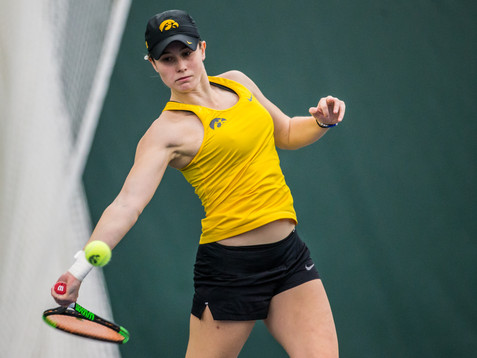Iowa's Elise Van Heuvelen Treadwell hits a forehand during a women's tennis matchup between Iowa and Iowa State at the Hawkeye Tennis and Recreation Complex on Friday, February 8, 2019.  The Hawkeyes dropped the doubles point but swept singles matches, defeating the Cyclones 4-1.
