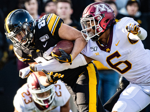 Iowa wideout Nico Ragaini lunges for a touchdown during a football game between Iowa and Minnesota at Kinnick Stadium on Saturday, Nov. 16, 2019. The Hawkeyes defeated the Gophers, 23-19.