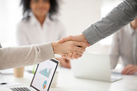 business-partners-handshaking-at-group-m