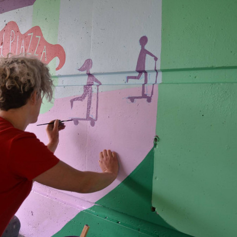 Amy Hutchings - stencilling the wall