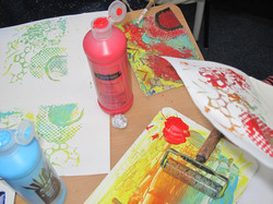 collograph block, roller and prints