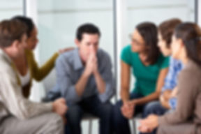 man-talking-with-small-group.jpg