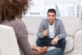 man-gestures-as-he-speaks-to-therapist.j