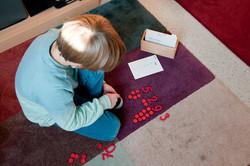 Montessori-GS-JungeGemusterterTeppich