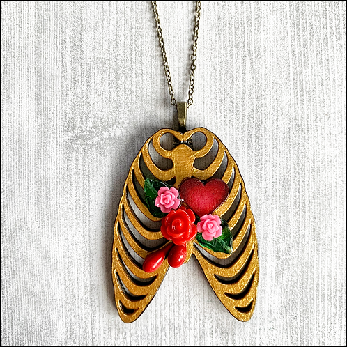 Gold Rib Cage And Heart Pendant Necklace