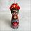 Thumbnail: Frida in Seven Hearts Mask Holding Heart Ornament