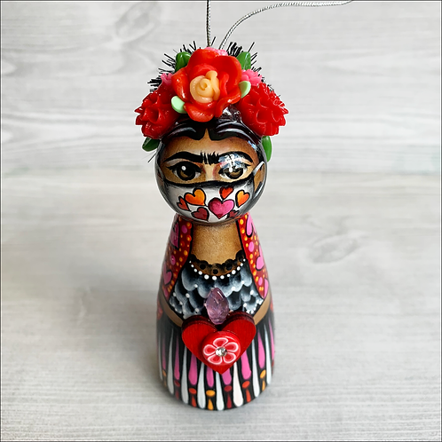 Frida in Seven Hearts Mask Holding Heart Ornament