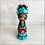 Thumbnail: Frida in Turquoise Scrubs and Heart Mask Holding Heart Ornament