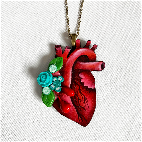 Anatomical Heart And Blue Flower Pendant Necklace