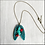 Thumbnail: Teal Blue Rib Cage And Heart Pendant Necklace