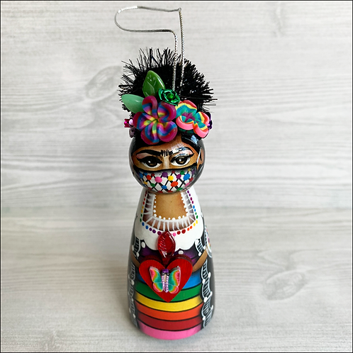 Frida in Rainbow Mask Holding Butterfly Heart Ornament