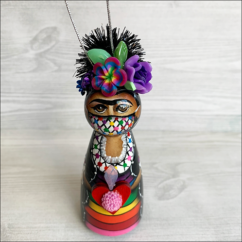 Frida in Rainbow Mask Holding Flowered Heart Ornament