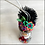 Thumbnail: Frida in Rainbow Mask Holding Butterfly Heart Ornament