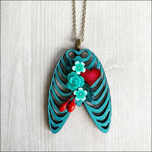 Teal Blue Rib Cage And Heart Pendant Necklace