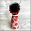 Thumbnail: Frida in Flowered Mask Holding Heart Ornament No.2