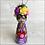 Thumbnail: Frida in Purple Mask Holding Heart Ornament