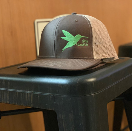 Brown hat with green hummingbird
