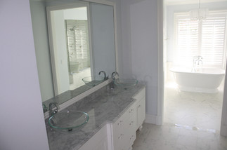 MARBLE VANITY WITH GLASS VESSEL SINKS