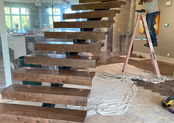Custom black walnut floating staircase