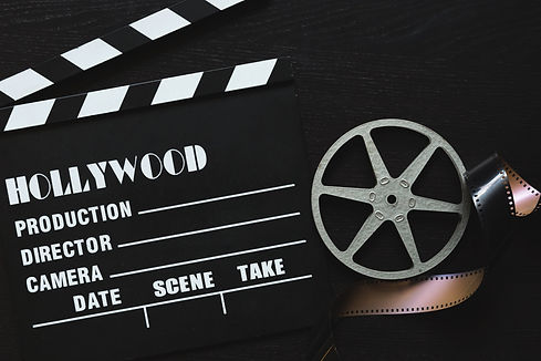 a-movie-clapper-board-film-roll-and-spro