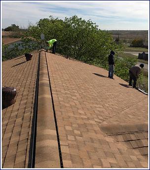Vented ridge cap on roof Tarrant County, TX.JPG