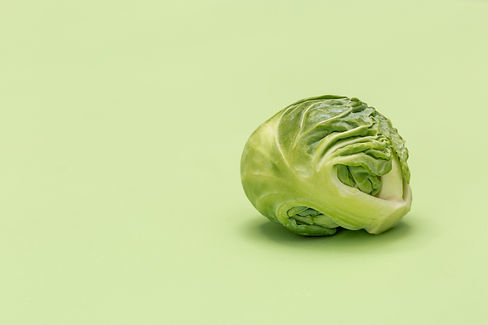 a-brussel-sprout-on-green-surface.jpg