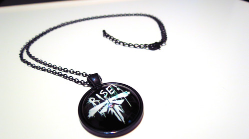 The last of us rise firefly necklace video games culver city based on the iconic firefly logo found inside the game this is a handmade necklace trapped inside a high definition glass dome with an extended chain for aloadofball Image collections