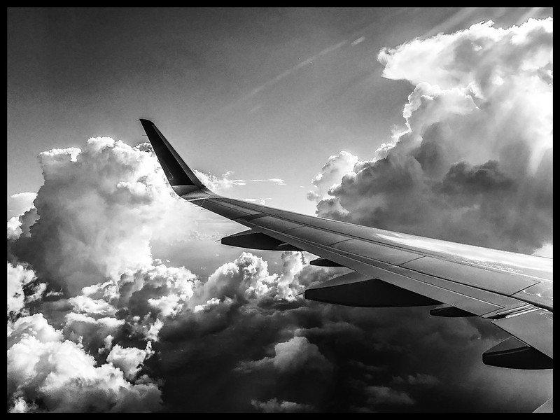 A321 Wing in Clouds.jpg
