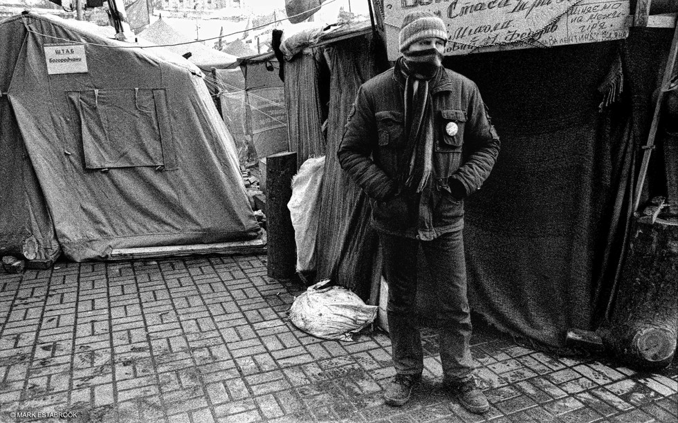 euromaidan man and tents CROP