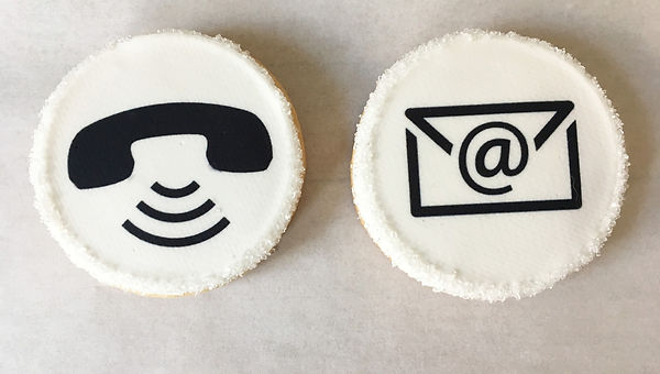 Blak and White Image of Telephone Icon and Email Icon on cookies