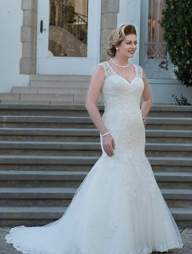 Lace sweetheart neckline with lace illusion straps. Lace mermaid gown with lace illusion back with covered buttons. Court length train.