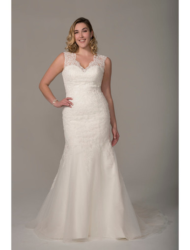Cascading lace adorns this classic fit and flare over a satin sweetheart neckline gown. Lace illusion keyhole back, finished with a lace up and a court length train.