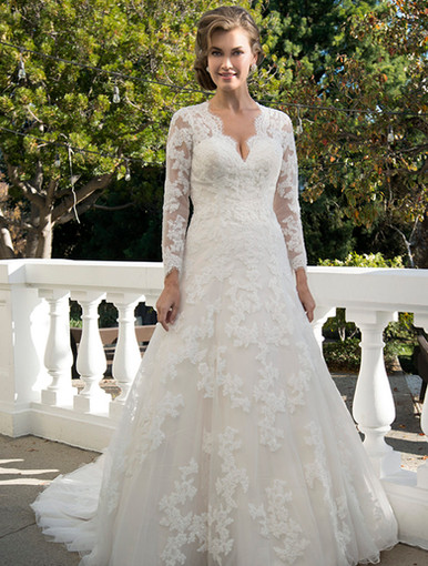 A-line gown with Queen Anne neckline and long illusion sleeves decorated with lace appliques. Illusion back with lace and buttons. Chapel length train.