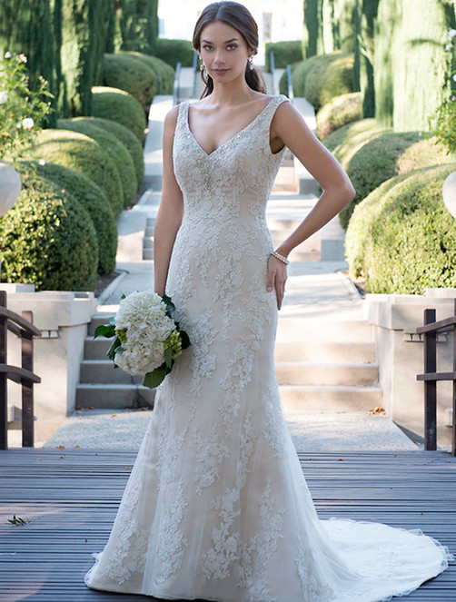 Sleeveless fitted mermaid gown with plunged V neckline adorned with beaded trim. Low back with zipper and Court length train.