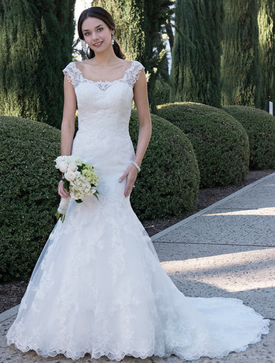 Fit & flare gown with sweetheart neckline and beaded illusion top. Low V back with zipper and buttons. Chapel length train.