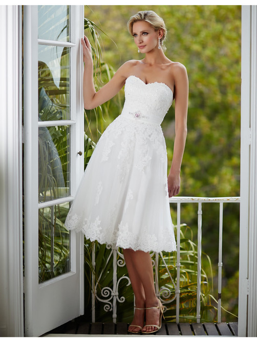 Short sweetheart strapless adorned with beaded lace appliques and satin band with beaded applique at waist. Zipper back with buttons.