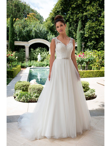 Sleeveless sweetheart with lace straps. Satin band at waist adorned with a beaded applique. Lace-up back.