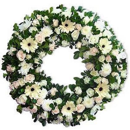 Corona funebre rosas con gerberas