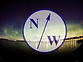 North Wind Adventurer Logo with northern lights background