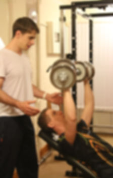 Instructing a client in their Lichfield home with personal trainer