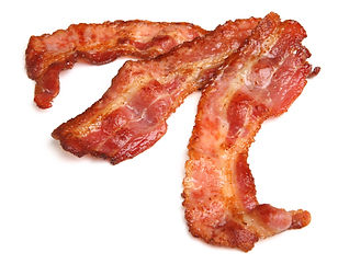 Cooked bacon strips on white background.