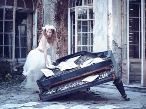White-skirt-girl-sheet-music-broken-pian