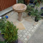setts around circular sandstone