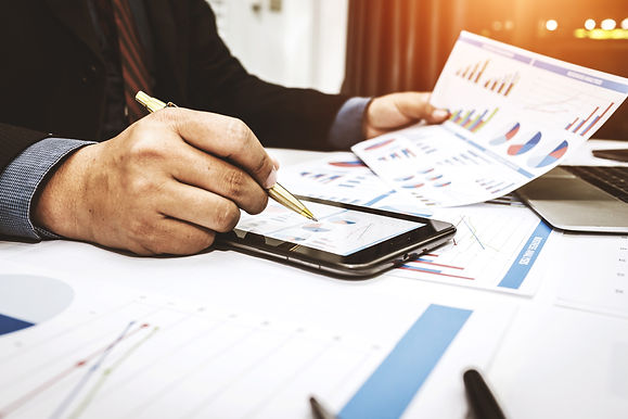 Bankers are analyzing financial data. To