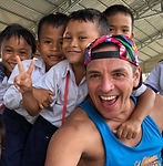M2E Team Leader John with kids in Cambod