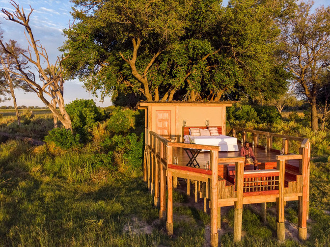 Sleep under the stars at Camp Okavango